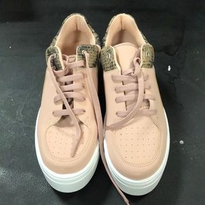 pink sneakers with snakeskin detail